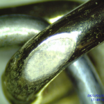 odhalený základný kov(striebro)
